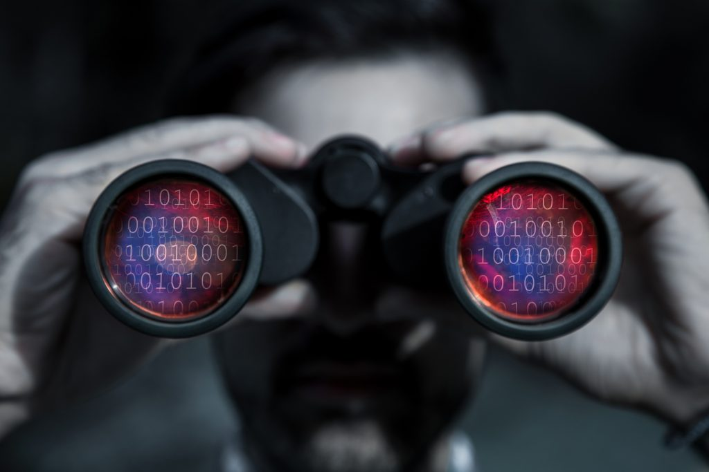 Hackers are able to spy on your data - man with binoculars